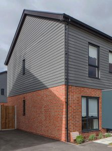 Cladding the upper story of a brick home in Melbourne